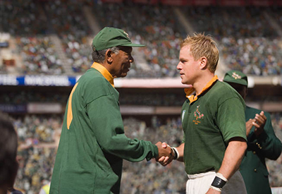Morgan Freeman as South Africa President Nelson Mandela shaking hands with South Africa Rugby Captain Francois Pienaar played by Matt Damon. Courtesy of Warner Bros.