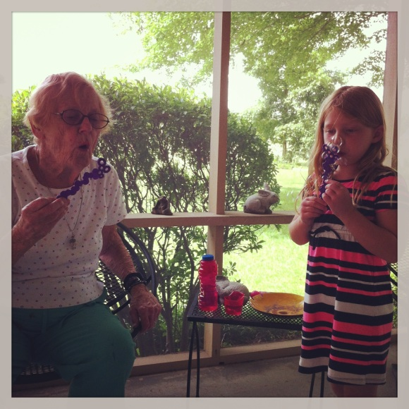 Gigi blowing bubbles with Madelyn