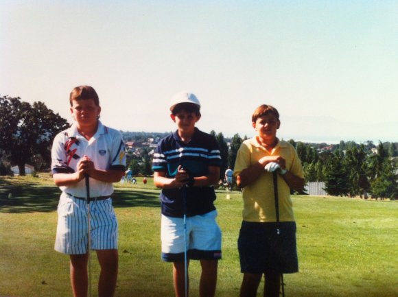Lining up with my playing partners at the UCT North American Golf Tournament. That is me in the middle. Nice visor!