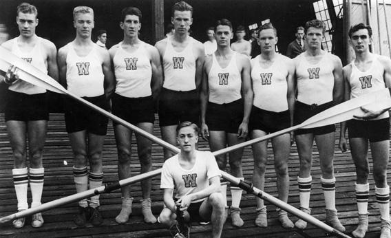 The 1936 U.S. Olympic rowing team from the University of Washington. From left: Don Hume, Joseph Rantz, George E. Hunt, James B. McMillin, John G. White, Gordon B. Adam, Charles Day, and Roger Morris. At center front is coxswain Robert G. Moch. Photo courtesy of University of Washington Libraries, Special Collections, UW2234.